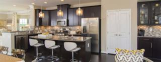 Greenbelt Station - Townhomes & Condos by Ryan Homes