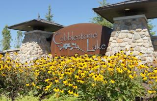 Reflection at Cobblestone Lake by Pulte Homes
