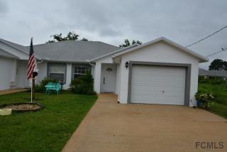 15 Buttonwood Ln, Palm Coast, FL 32137