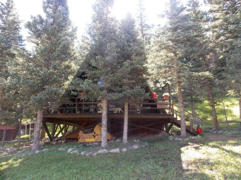in view rent retreat cabins nm river for red of