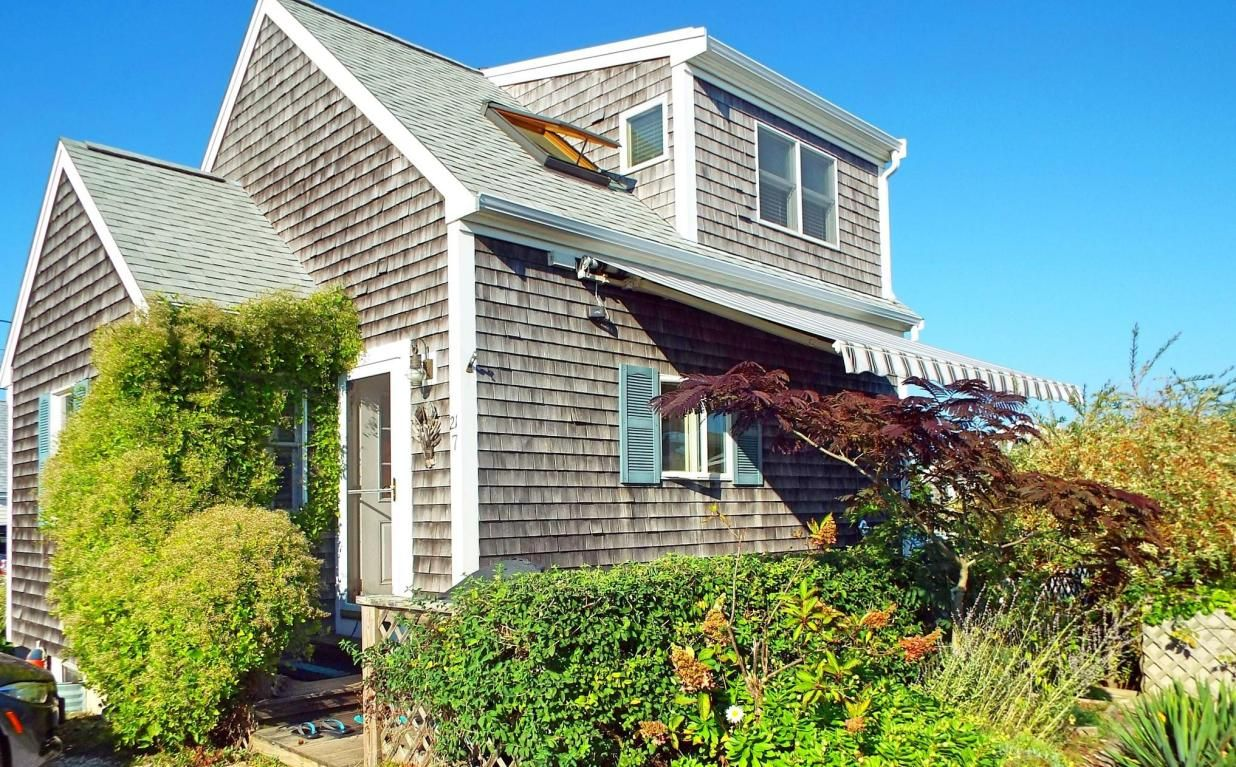 ma rt and a photo in provincetown between of on boarded truro day stock massachusetts cottages up row january