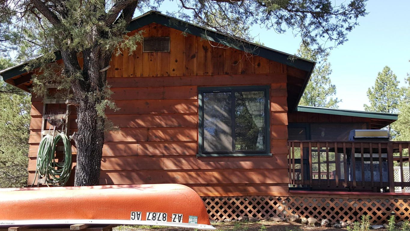 ponderosa views prescott rental this frame cottage boasts home feet deck forest park of br cabins w beautiful cabin a over vacation square